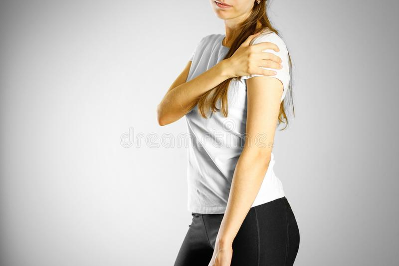 A young girl sore arm. The pain in my arm stock photography