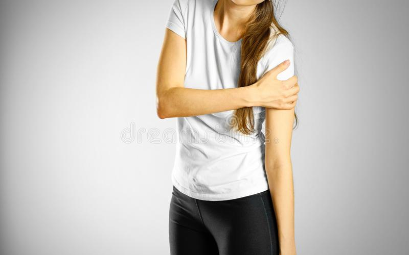 A young girl sore arm. The pain in my arm stock images