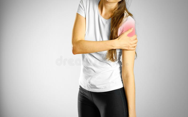 A young girl sore arm. The pain in my arm. The location of the p stock photography