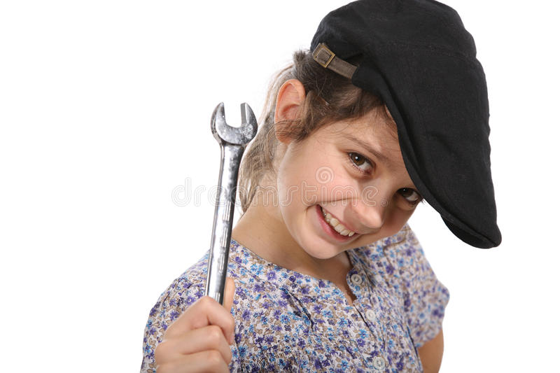 Young girl with a spanner royalty free stock photo