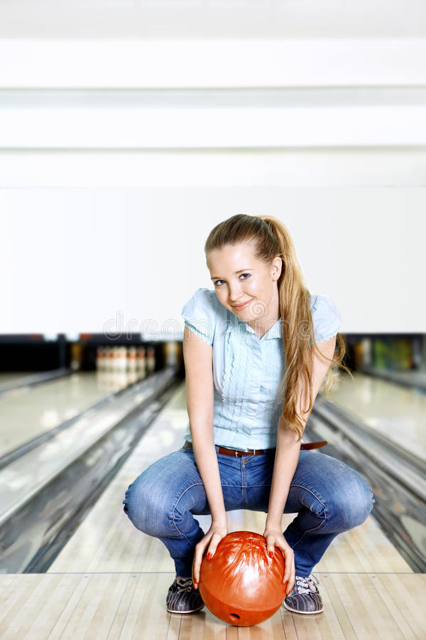The young girl with a sphere stock photography