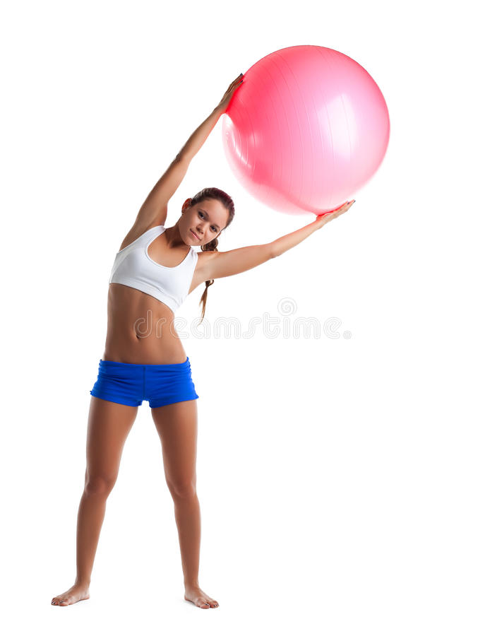 Young Girl Stand With Fitness Ball Isolated Royalty Free Stock Photos