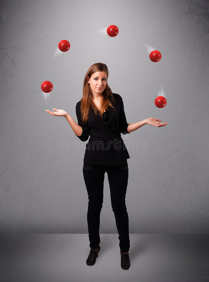Download Young Girl Standing And Juggling With Red Balls Stock Photos - Image: 28655873