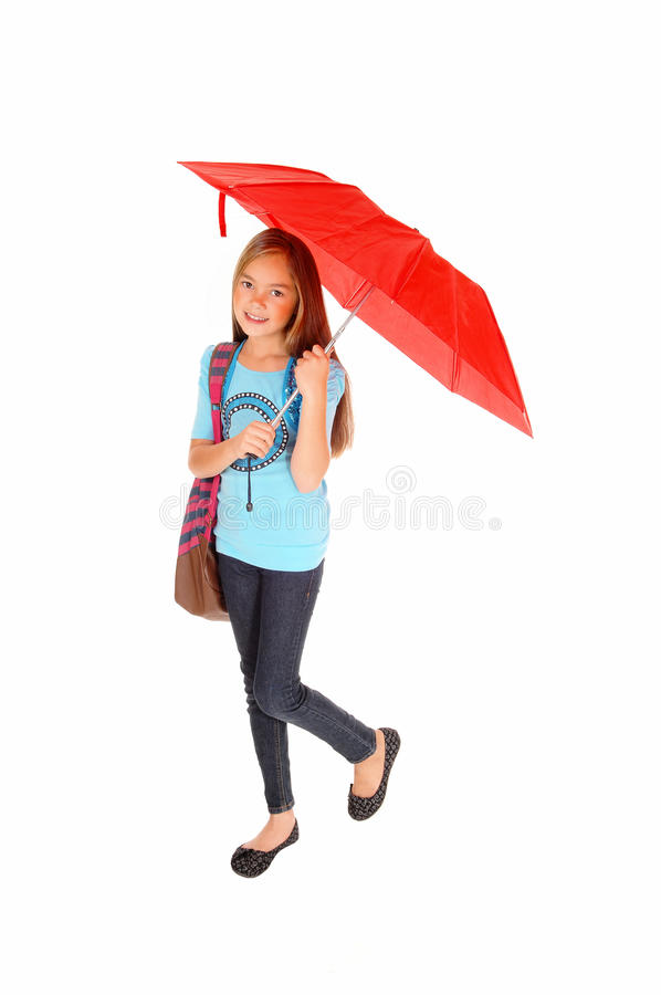 Young girl standing with umbrella. royalty free stock photos