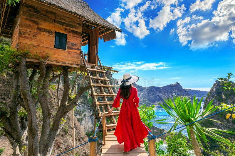 Young girl on steps of house on tree at Atuh beach in Nusa Penida island, Bali in Indonesia. royalty free stock photography