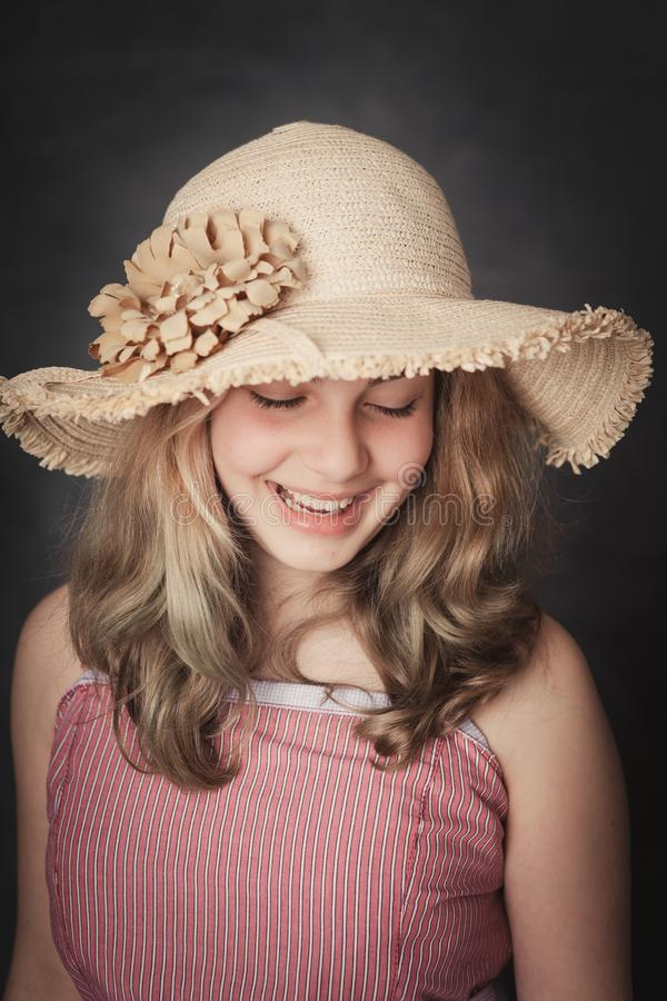 Young girl with strawhat smiling royalty free stock photos