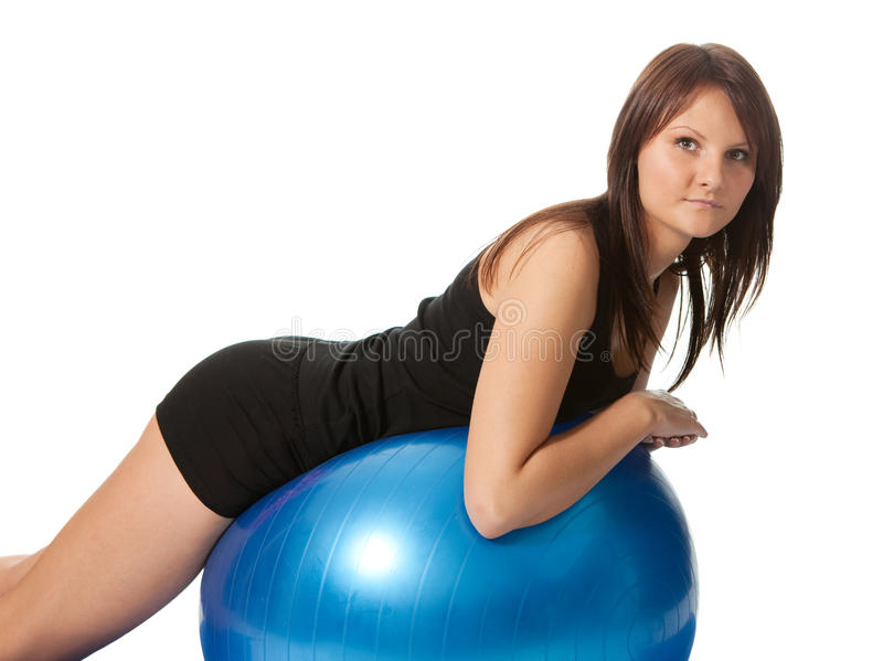 Young girl stretching back on fitness ball royalty free stock images