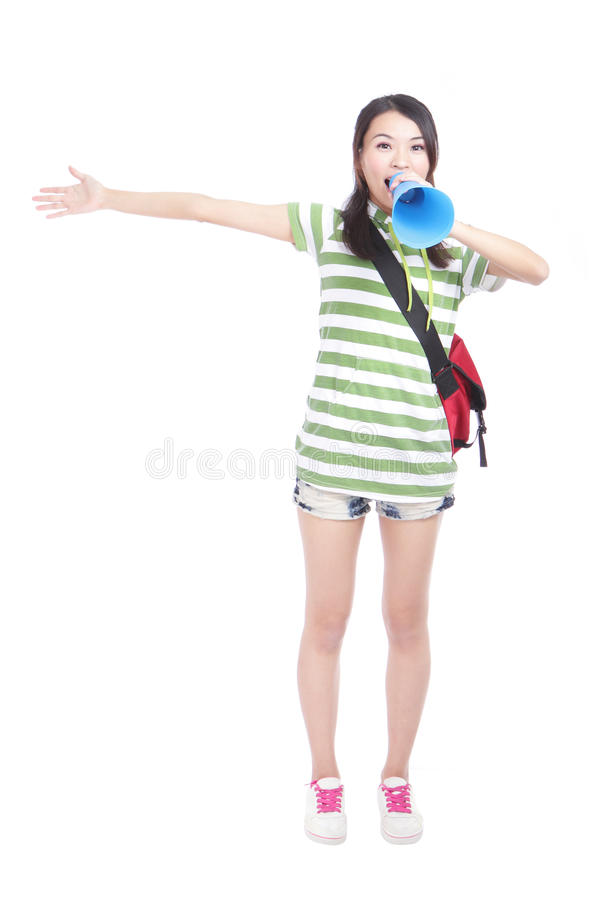 Young girl student yelling and talking to you. Through megaphone with full length isolated on white background, model is a asian girl royalty free stock photography