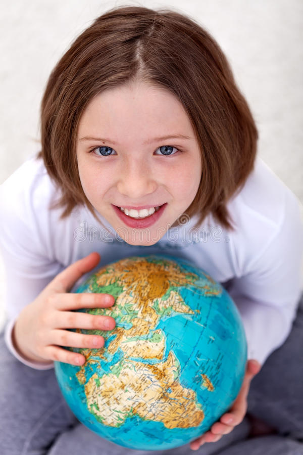 Young Girl Studying Geography Royalty Free Stock Image