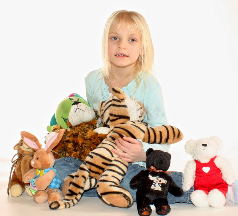 Young girl and stuffed animals royalty free stock images
