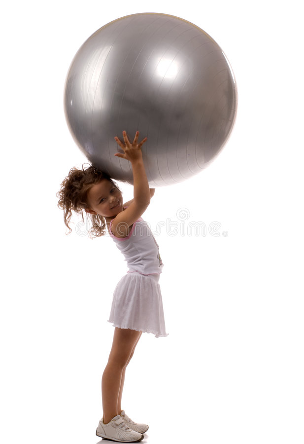 A young girl stuffed ball stock photo