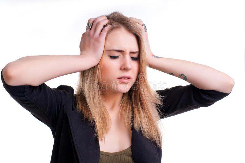 Young girl suffering from headache on a white background