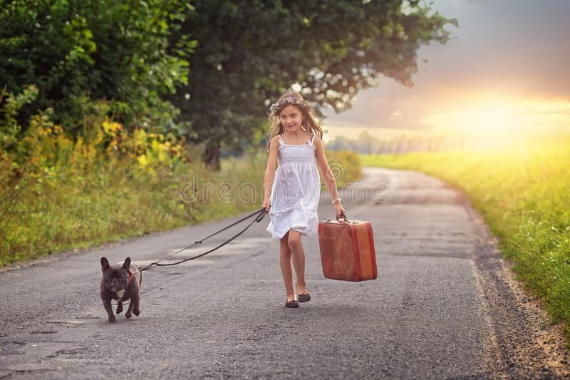 Young girl with suitcase stock photo