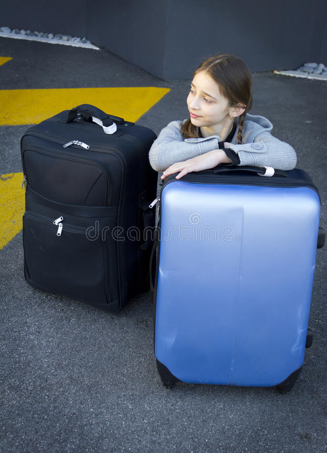 Download Young girl with suitcases stock photo. Image of background - 36008288