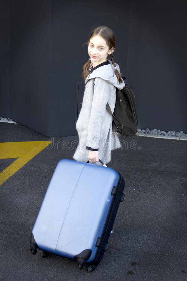 Young girl with suitcases