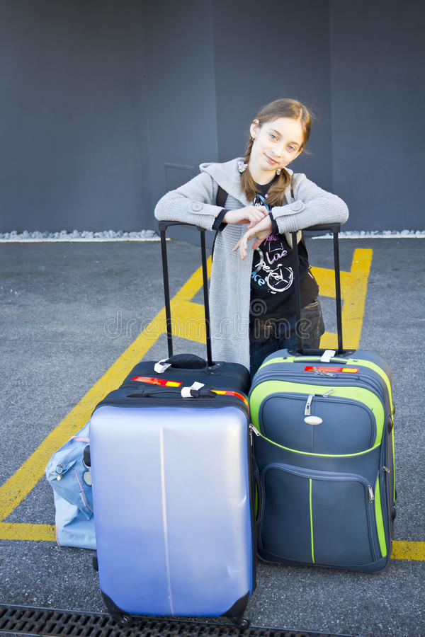 Download Young Girl With Suitcases Royalty Free Stock Image - Image: 36850376