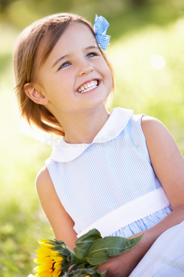 Download Young Girl In Summer Field Holding Sunflower Royalty Free Stock Image - Image: 26106426