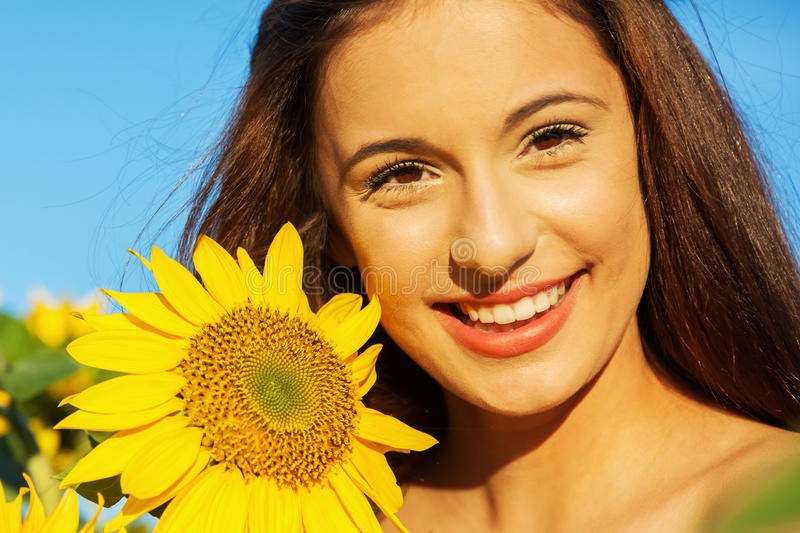 Young girl with sunflower stock photos