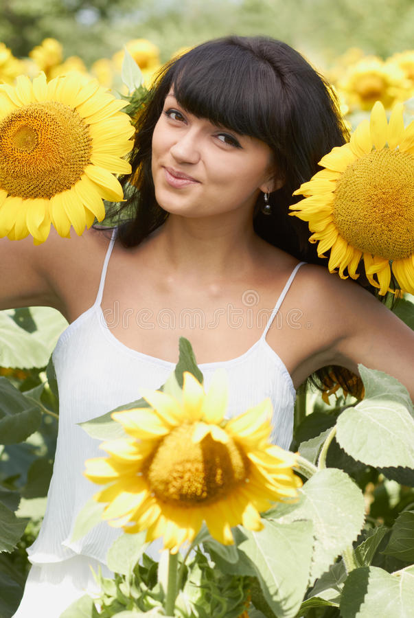 Download Young Girl With Sunflowers In Field Stock Photo - Image: 25872258