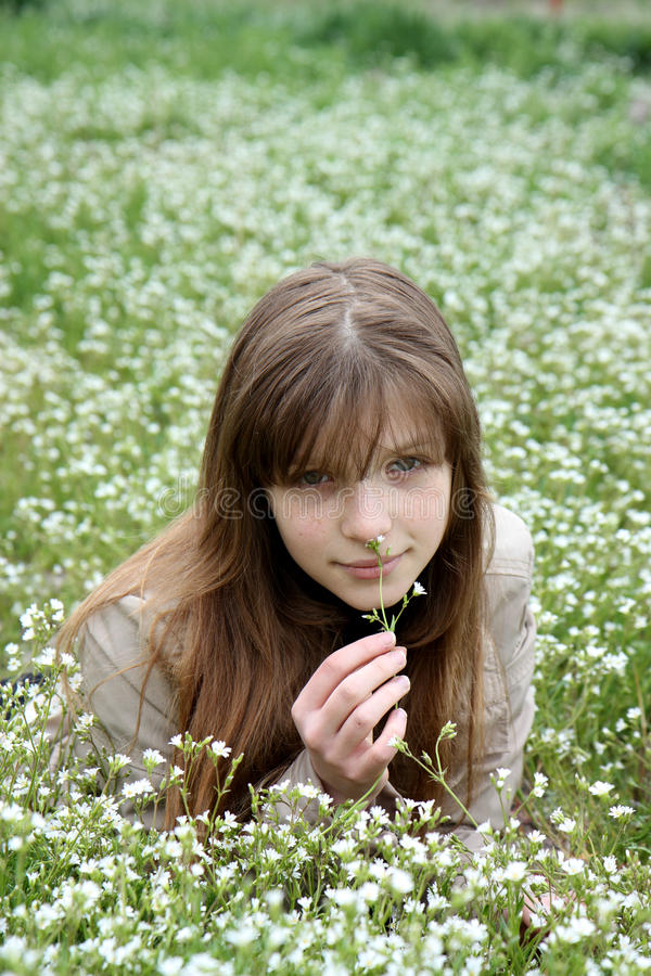 Young girl surrounded with  a lot of white flowers