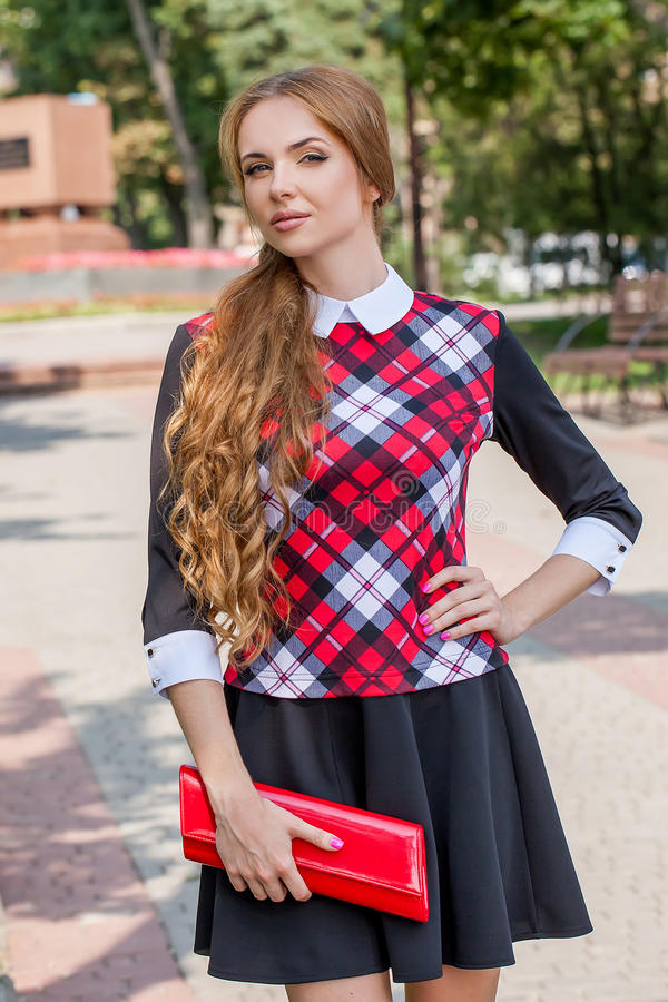 Young girl in sweater posing on the street, the portrait mood, s royalty free stock photo