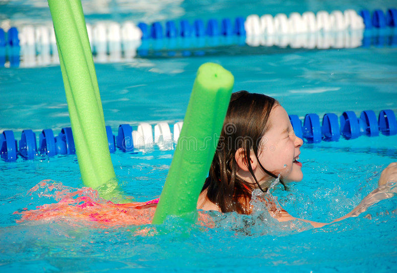 Download Young Girl At Swimming Lesson Royalty Free Stock Photography - Image: 4834767