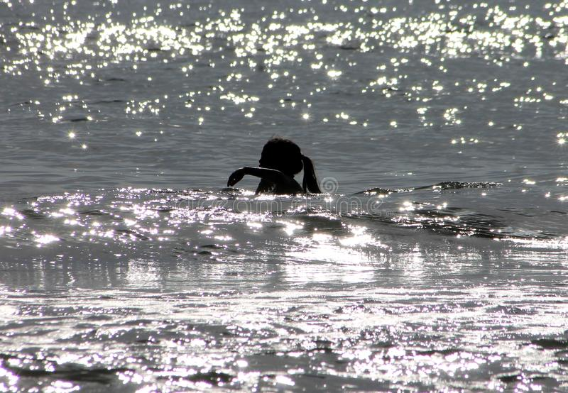 Young Girl Swimming in Ocean royalty free stock image