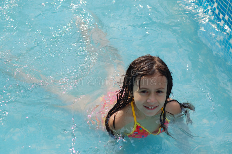 young girl swimming in pool stock image image 2915481