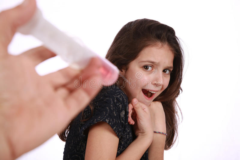 Young girl and syringe royalty free stock photos