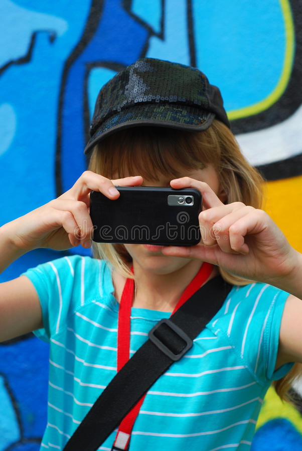 Download Young Girl Taking Photo With Mobile Phone Stock Photo - Image: 24767402