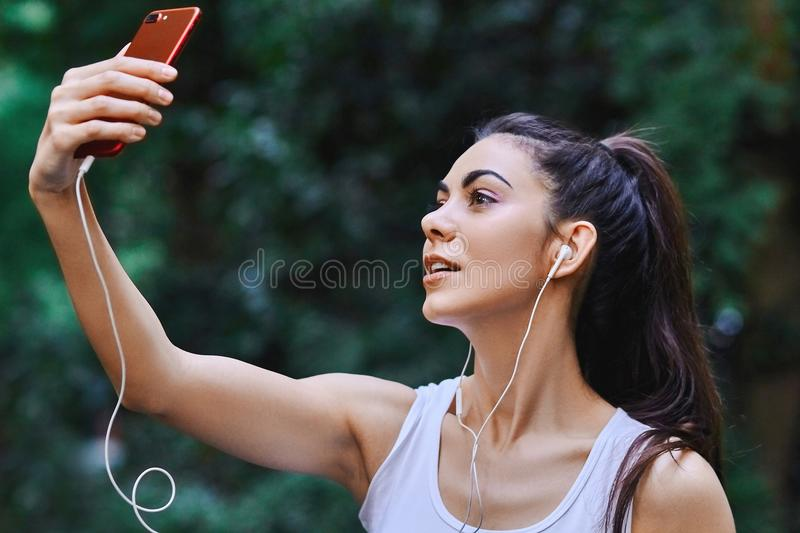 Young girl is taking selfie stock photos