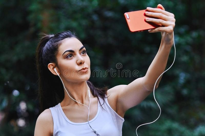 Young girl is taking selfie stock photo
