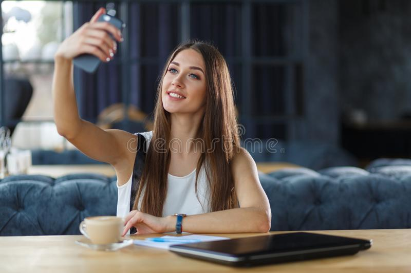 A young girl is taking selfie stock images