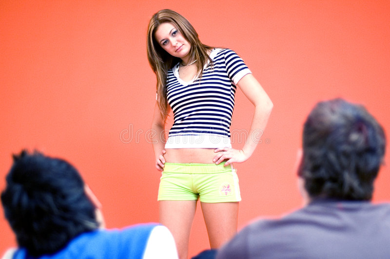 Young girl talking with guys royalty free stock image