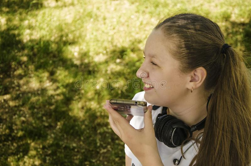 A young girl talking on the phone stock images