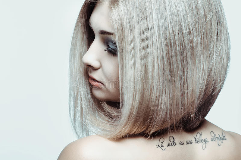 Young girl with tattoo royalty free stock photos