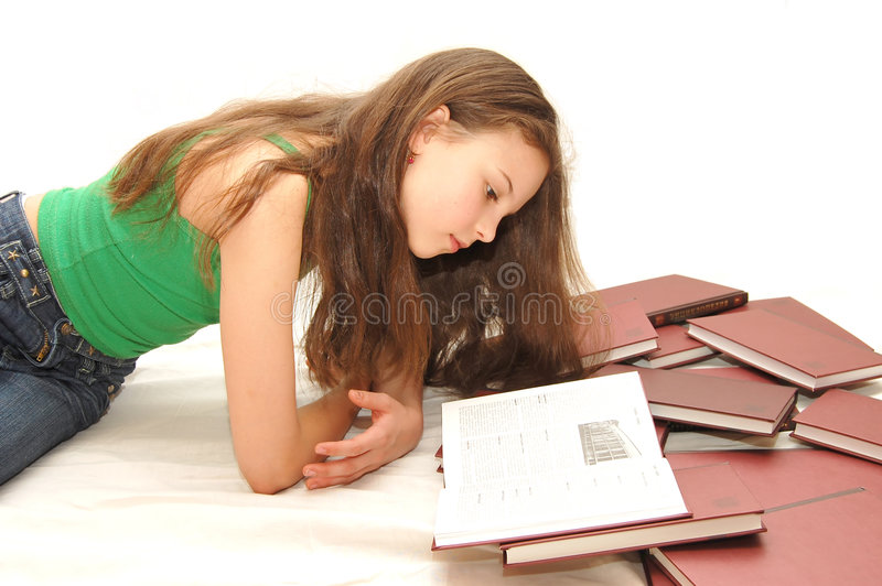 The young girl the teenager reads books royalty free stock photography