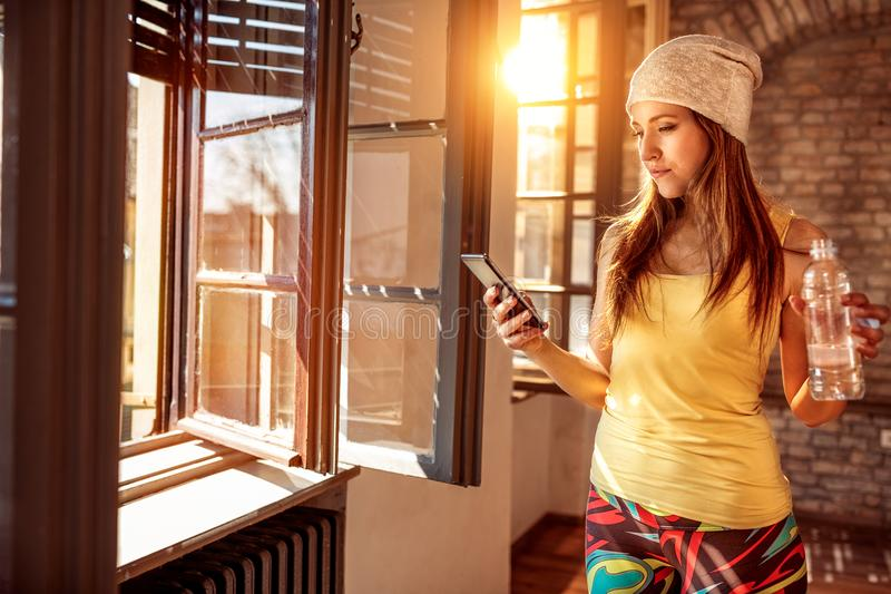 Young girl texting on the smartphone stock image