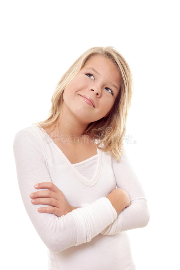 Young girl thinking. Cute little preteen girl thinking about something stock images