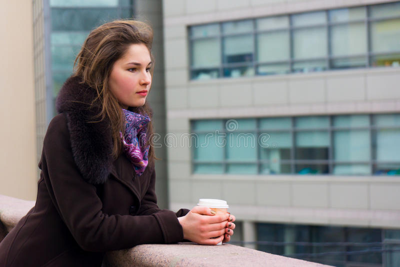 Young girl thinking with a cup of coffee stock photo