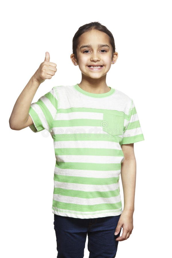 Young girl with thumbs up smiling stock photos