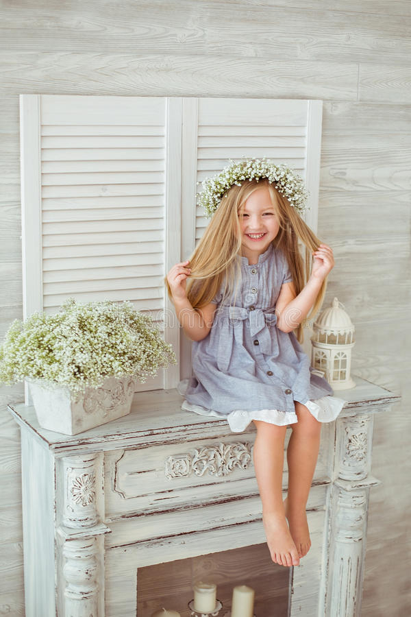 A young girl is tiding her hair royalty free stock photos
