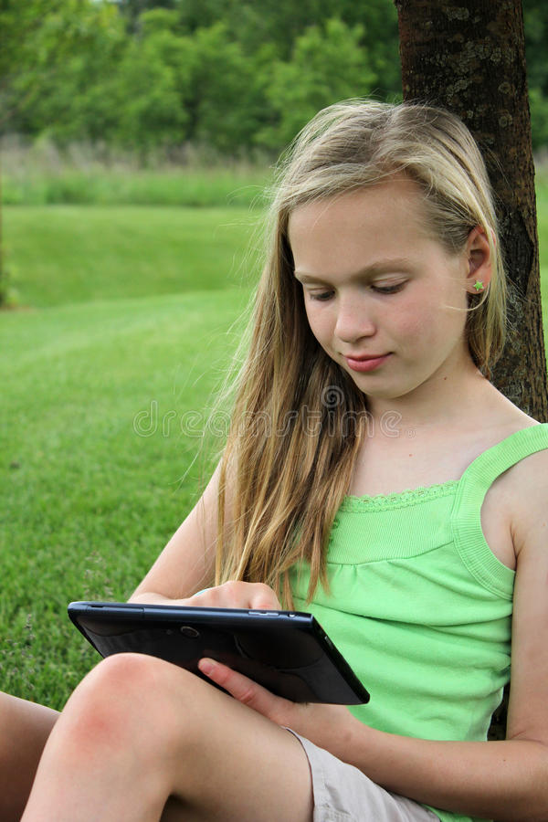 Download Young Girl With Touch Tablet Stock Photo - Image: 25281526