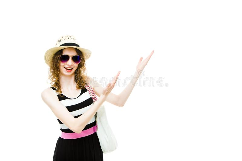Young girl tourist in summer outfit pointing on white blanket space stock photo