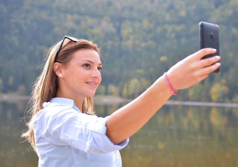 Young girl tourist takes selfie stock photography