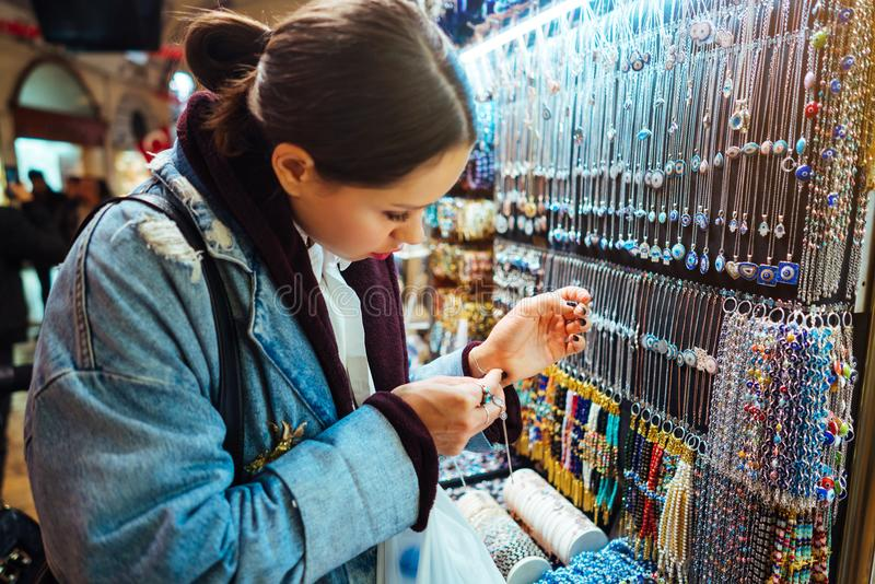Young girl tourist walking in the souvenir market royalty free stock photography
