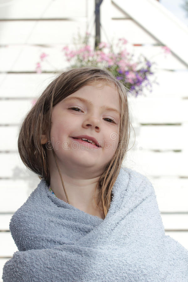 Young girl with a towel royalty free stock images