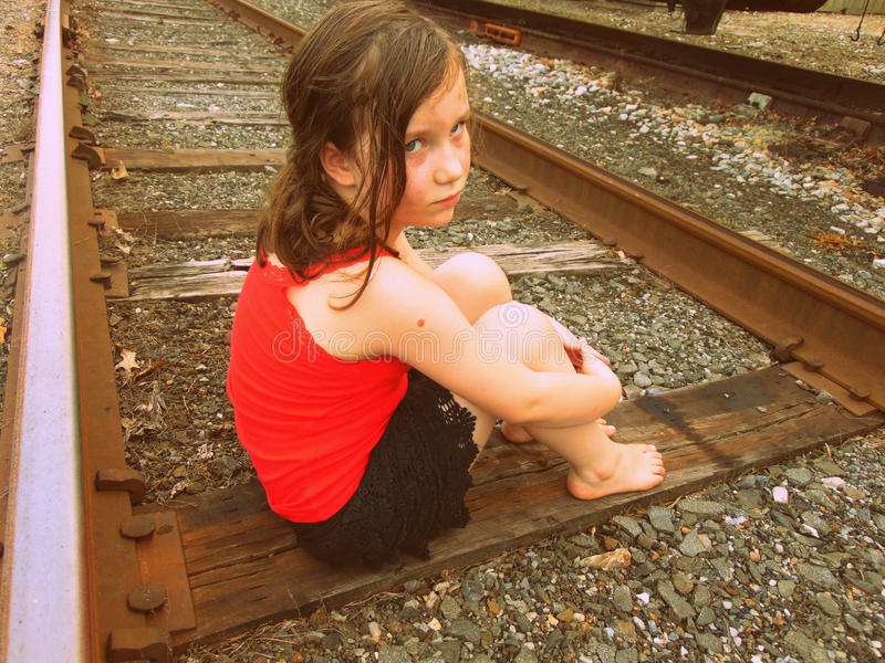Young Girl On Train Tracks royalty free stock image