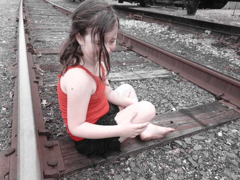 Young Girl On Train Tracks royalty free stock images