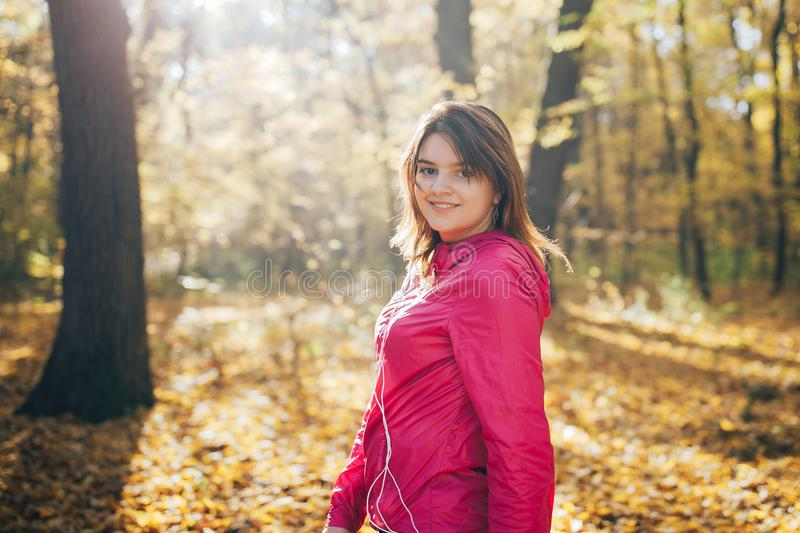 Young girl trains in the morning autumn park. Close up portrait stock images
